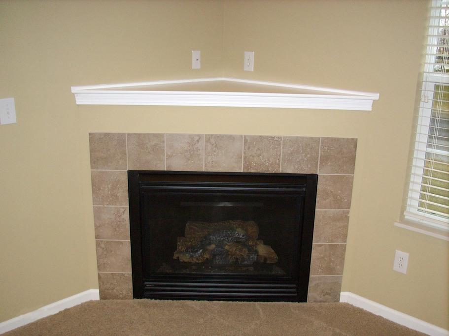 Image of: corner gas fireplace design ideas